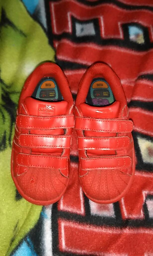 Girls red adidas trainers, size 7.