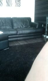2x3 seater black leather dfs sofas good condition well looked after undet 2 years old