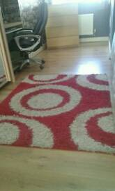 Rug in cream and red