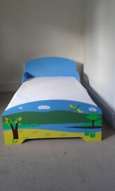 Dinosaur wooden toddler bed with mattress and cover sheet