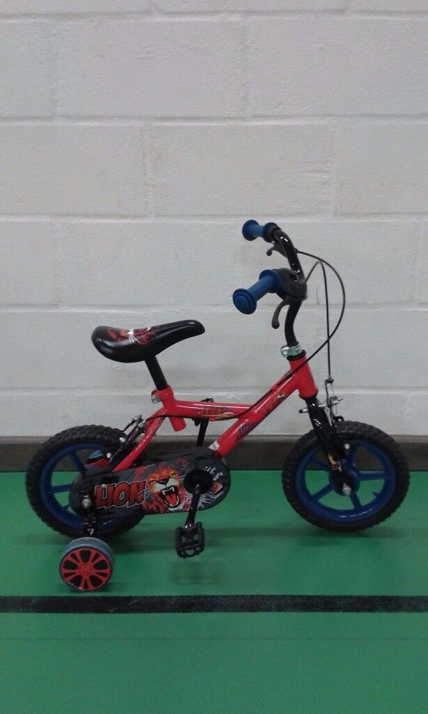 1st bike for a boy - Lion themed with stabilisers, suit 3-5 year olds. Great condition.