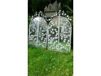 Two shabby chic garden mirrors