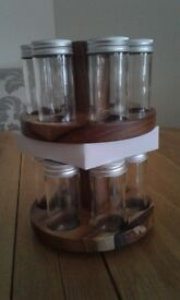 Brand new revolving spice rack with 12 containers