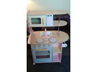 Kidcraft Wooden Toy Kitchen with lots of wooden accessories and food
