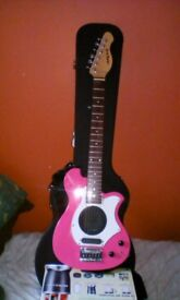 Aria Traveller 6 string Electric Guitar with Built-In Amplifier.