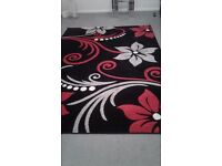 Black, red and grey rug