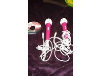 karaoke microphones two off them in pink clean