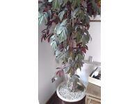 Atrificial plant with pot base
