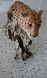 Leopard head on branch ornament. Attractive.