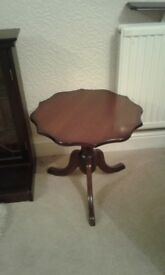 Round wooden occasional table.