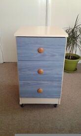 Latte / Blue bedside cabinet.