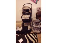 £50 Leopard print pushchair with carry cot and carseat