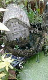 Water feature with pump