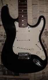 Electric guitar Strat copy Black by Encore.