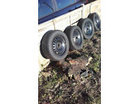 Snow/winter tyres on steel wheels for Ford 5-stud fitting
