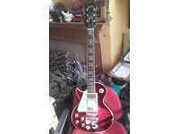 2 highly modified left-handed Les Paul guitars, Pete Townshend tribute guitars