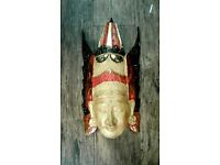 Very nice wooden hand carved and hand painted, wall mounted ethnic mask.