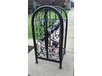 cast iron wine rack with lockable cage