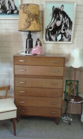 Mid century tall drawer, set of 6 in light teak with original handles, lovely shape
