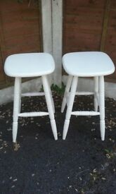 2 wooden stools painted white