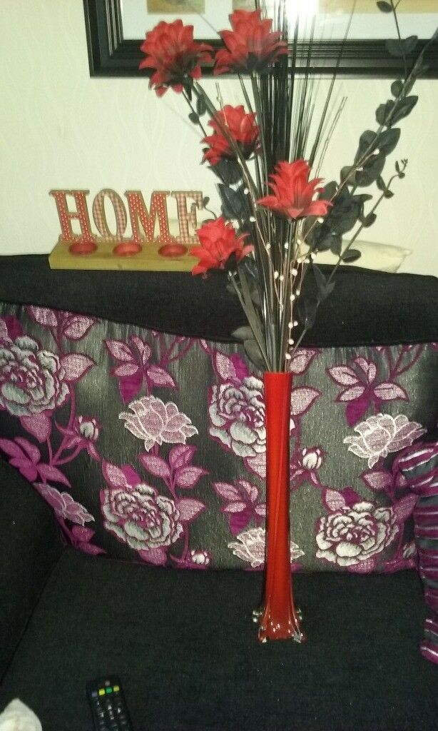 """Red flowers and vase and red """"home"""" candle holders"""