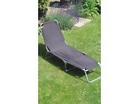 Two Black Sun Loungers hardly used.