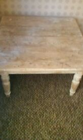 Solid wood table 2ft 32 width and 1ft 18 long .you can strip it wax it paint it
