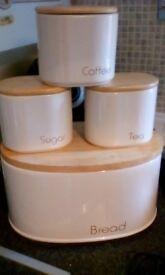 Cream ceramic bread, tea, coffee, sugar containers and cream metal pedal bin