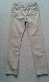2 pairs of girls jeans. Good condition. 1 pair sparkly gold. 1 pair navy with with flowers.