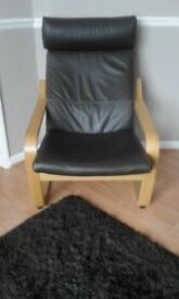 Second hand brown leather armchair