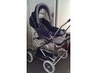 SILVER CROSS PUSHCHAIR - Navy and White pushchair with footmuff and bag.