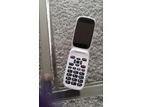 Doro 6520 mobile phone . Brand new never been used . Colour white