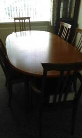 Extending oval teak table and 6chairs as new