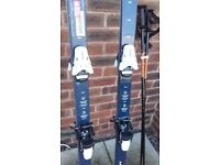Two pairs of alpine skis