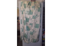 attractive green/white patterned curtains
