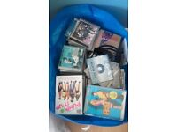 A job lot of DVD's CD singles and Albums