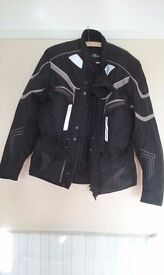 crane motorbike jacket trousers and gloves