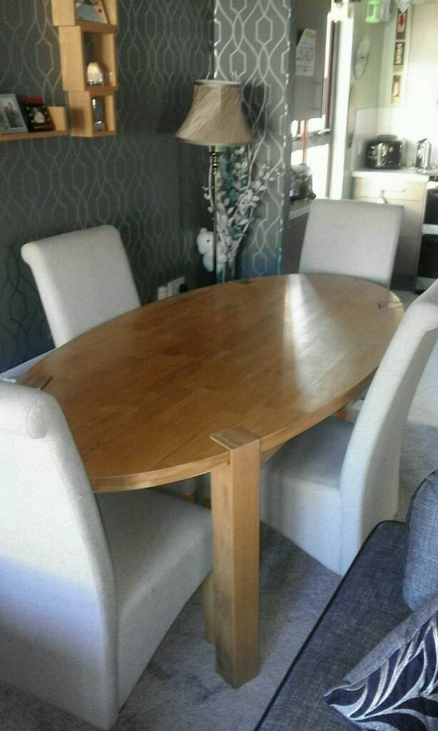 SOLID OAK OVAL TABLE & 4 FABRIC CHAIRS