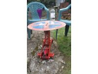 upcycled handmade trolley jack, round road sign top, garden table