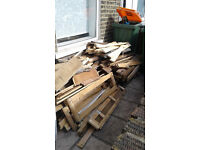 timber logs wood cut boards asorted dry ready for collection in Forest Gate