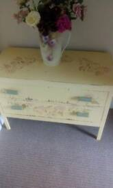 Small decorated chest of drawers