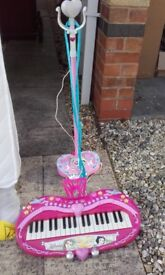 Disney princess key board and stand up microphone.