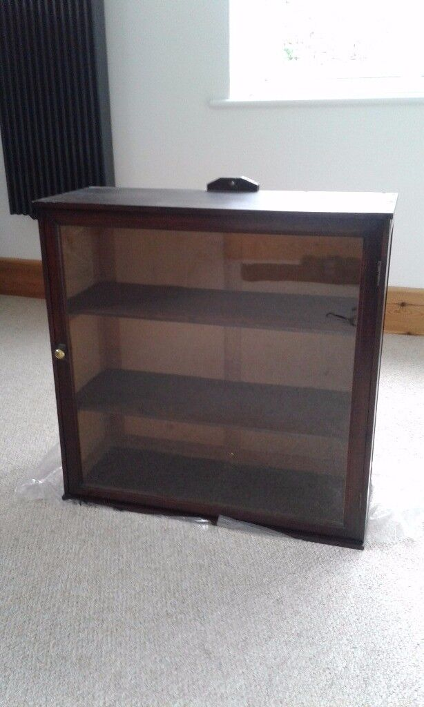 Small good quality Display cabinet wooden with glass door very good condition
