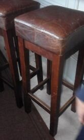 Wonderful pair of vintage style tall Hide Leather and Solid Wood barstools!