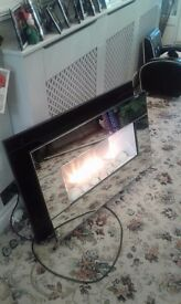 Mirrored wall mounted electric fire good condition except for small chip in mirror.