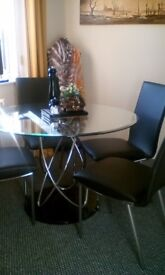 Glass Dinning Room Table and Chairs