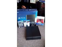 boxed ps4 with 2 official controllers and 135 blurays and 5 months warranty with game