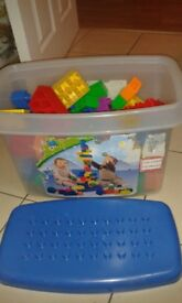 Lego Quatro, shape sorters, musical wooden mouse, dolls baby bath, toy laptop and barn