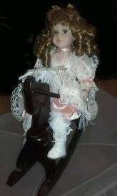 A Collection of 12 Porcelain Dolls and Accessories