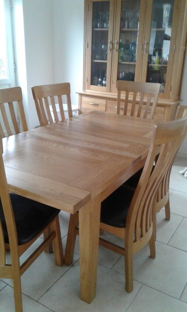 Solid Oak table and 6 chairs suitable for kitchen or ...